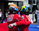 Fernando Alonso consoles Felipe Massa