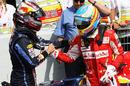 Sebastian Vettel congratulates Fernando Alonso