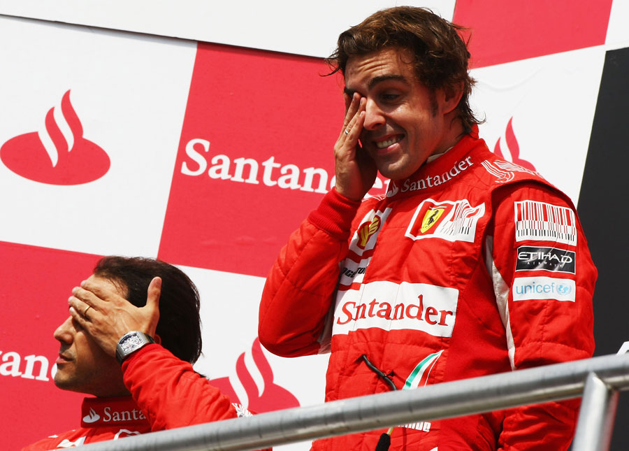 The contrasting emotions of Felipe Massa and Fernando Alonso is clear to see on the podium
