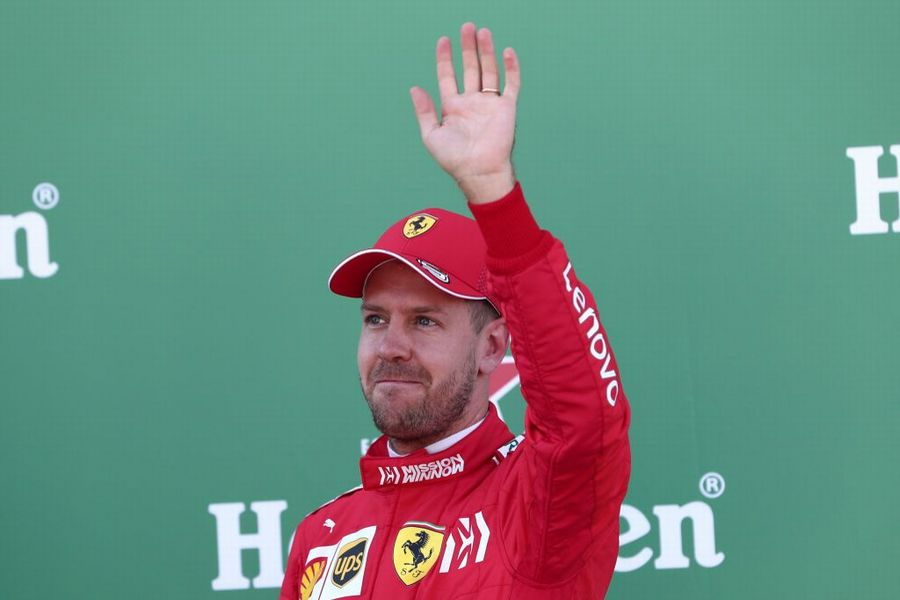 Pole sitter Sebastian Vettel celebrates in parc ferme
