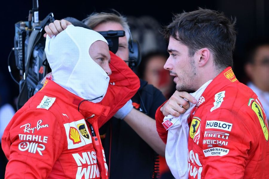 Sebastian Vettel speaks with Charles Leclerc in parc ferme after the race