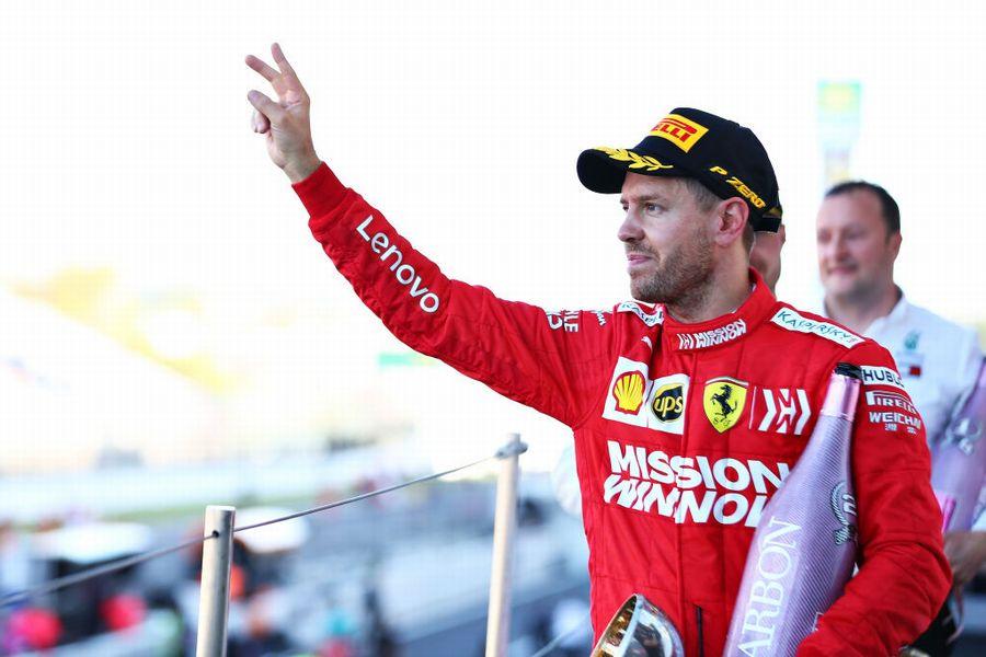 Sebastian Vettel celebrate on the podium