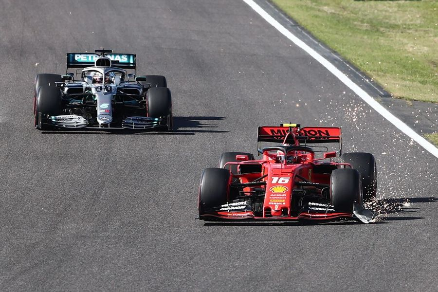 Charles Leclerc leads Lewis Hamilton on track