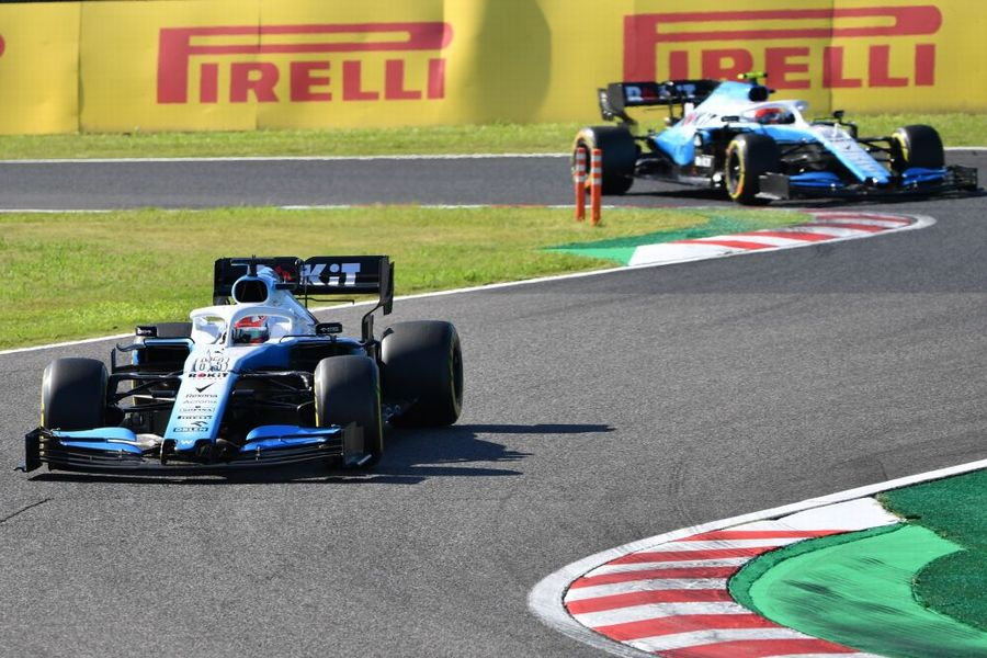 George Russell leads Robert Kubica on track in the Williams
