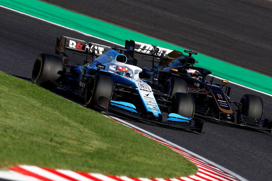 George Russell and Romain Grosjean battle for position