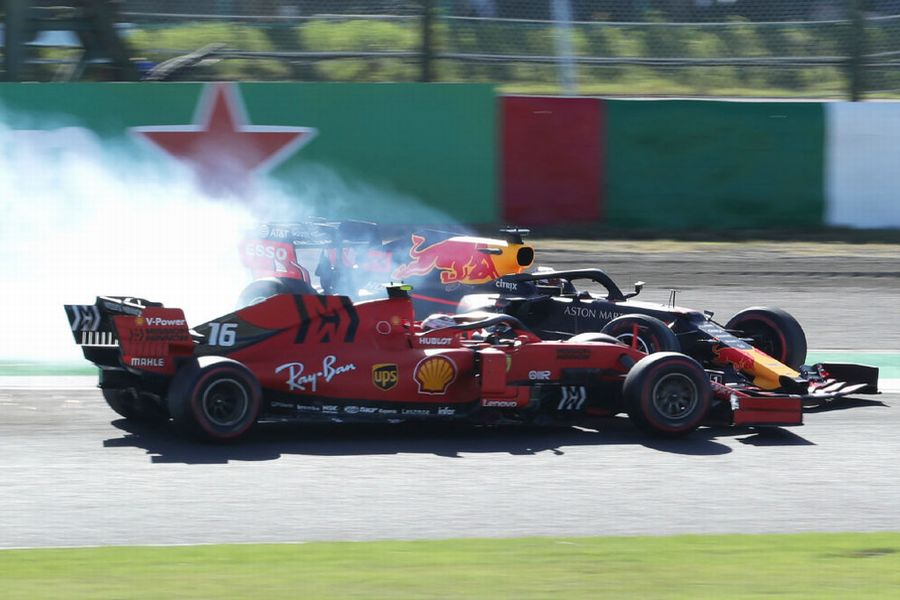 Max Verstappen collides with Charles Leclerc after the start