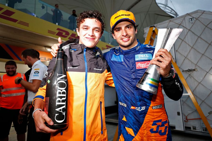 Carlos Sainz Jr celebrates after later being awarded third place with Lando Norris