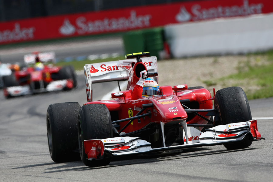 Fernando Alonso leads home Felipe Massa