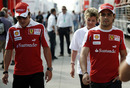 Fernando Alonso and Felipe Massa walk the paddock