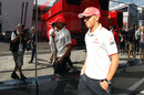 Lewis Hamilton walks past the McLaren motorhome