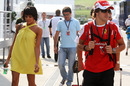 Fernando Alonso arrives in the paddock with his wife Raquel del Rosario