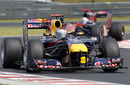 Sebastian Vettel's Red Bull leads Sebastien Buemi in the Toro Rosso