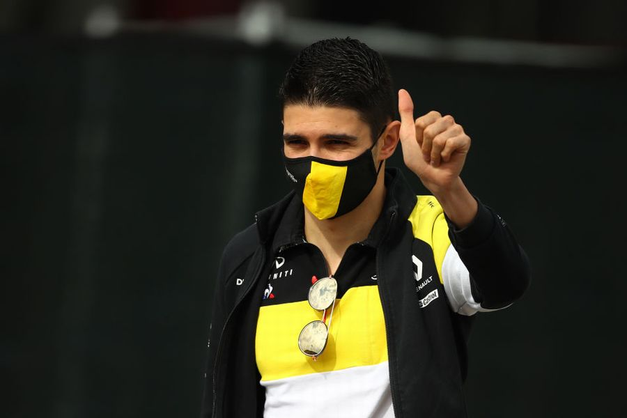 Esteban Ocon gives a thumbs up in the Paddock