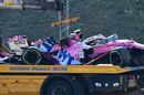 The car of Lance Stroll is seen on a tow truck following a crash