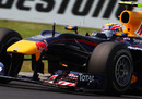 Mark Webber corners hard in the Red Bull