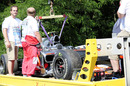 Lewis Hamilton's stricken car is towed away