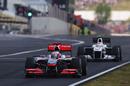 Jenson Button leads Kamui Kobayashi