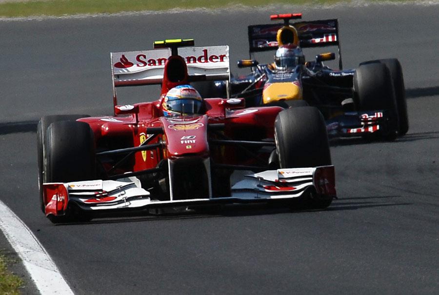 Fernando Alonso keeps Sebastian Vettel behind him