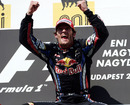 A delighted Mark Webber celebrates victory on the podium