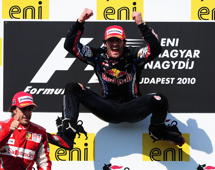 A delighted Mark Webber jumps for joy