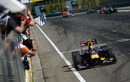 Mark Webber takes the chequered flag for victory