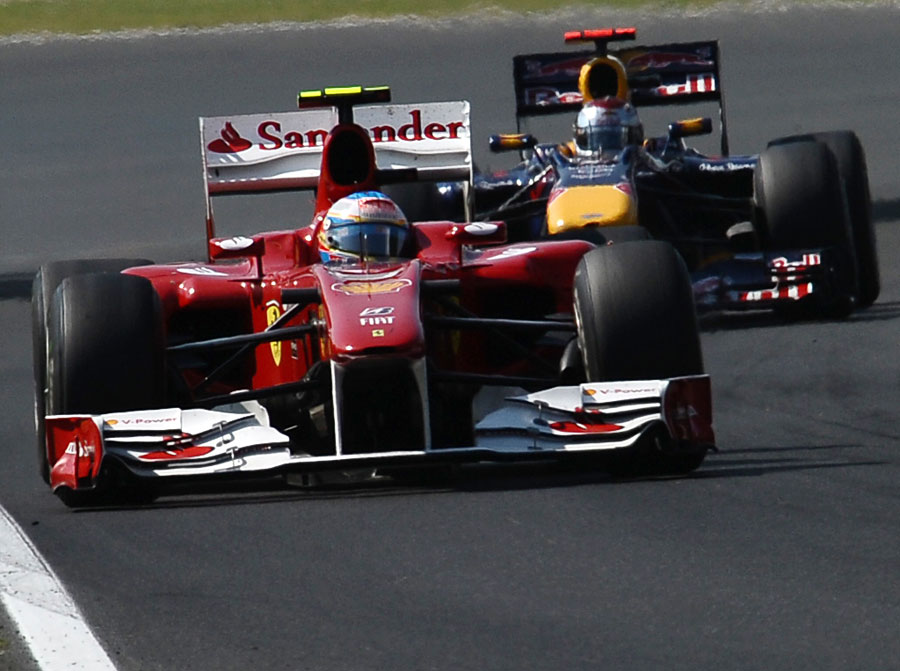 Fernando Alonso holds off Sebastian Vettel