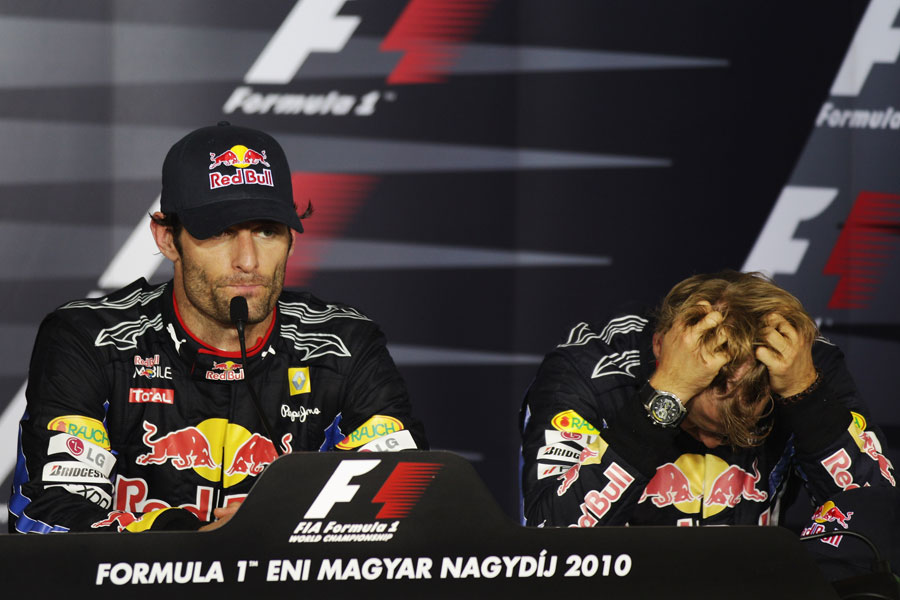 Sebastian Vettel looks less than happy in the post-race conference