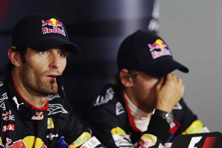 Mark Webber answers questions as Sebastian Vettel contemplates what might have been
