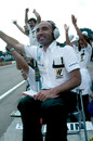 Frank Williams celebrates Alan Jones's second consecutive victory and the third in a row for his Williams team