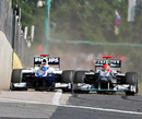 Michael Schumacher leaves Rubens Barrichello very little space as he tries to pass