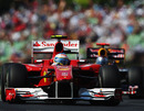 Fernando Alonso in the Ferrari leads Sebastian Vettel's Red Bull