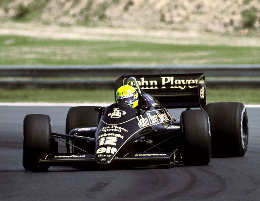 Ayrton Senna holds a huge slide in his Lotus