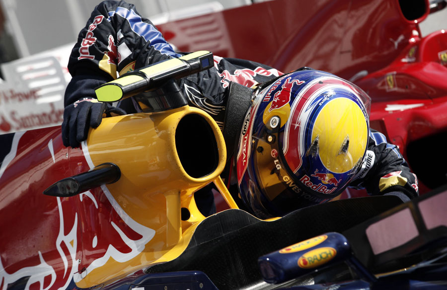 Mark Webber kisses his car after his first victory of the season