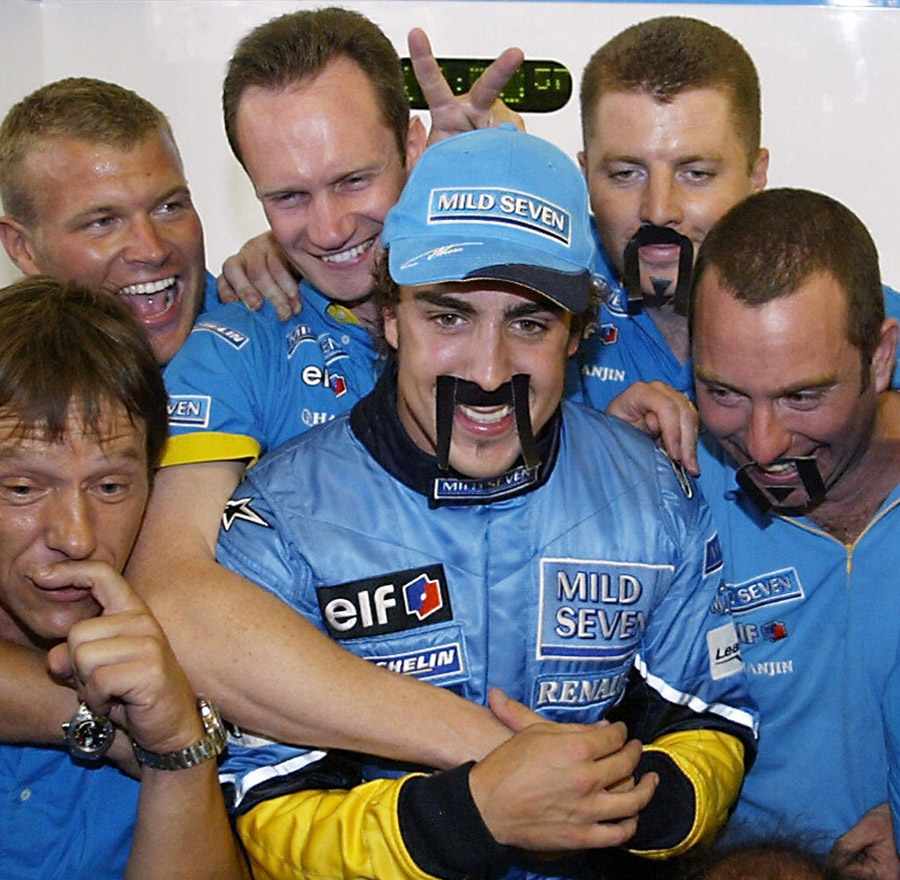 Fernando Alonso celebrates winning the Hungarian Grand Prix