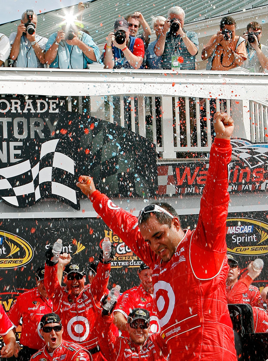 Juan Pablo Montoya celebrates victory at the NASCAR Sprint Cup Series at Watkins Glen