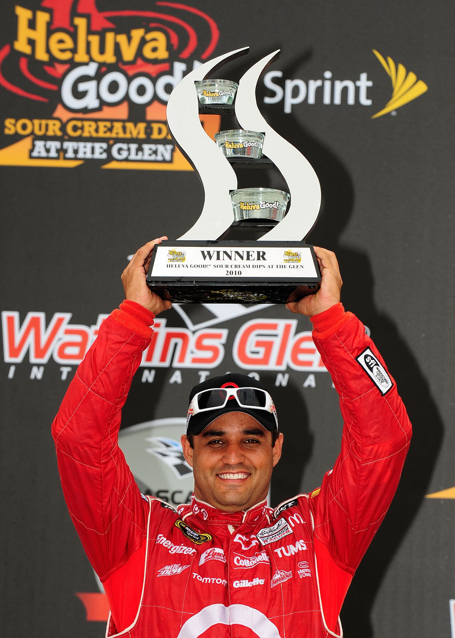 Juan Pablo Montoya with his winners' trophy at the NASCAR Sprint Cup Series at Watkins Glen
