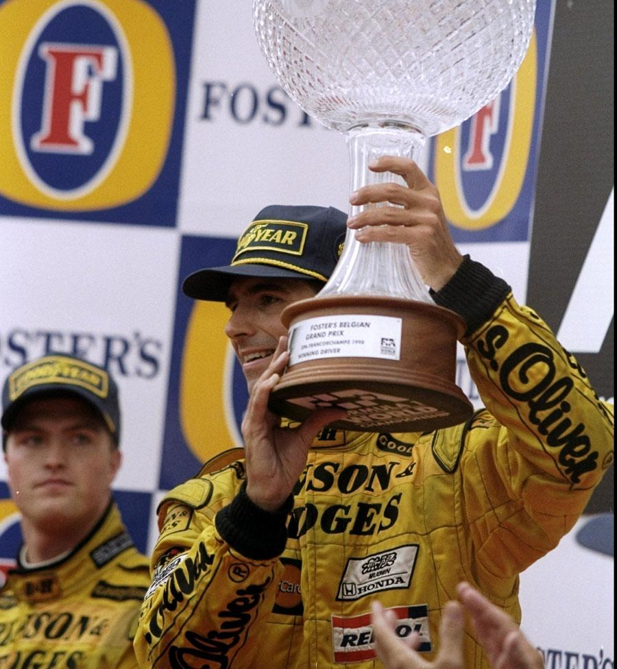 Damon Hill celebrates winning the Belgian Grand Prix as Ralf Schumacher looks on