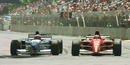 Gerhard Berger goes wheel to wheel with Michael Schumacher