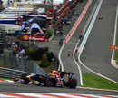 Mark Webber powers through Eau Rouge during qualifying