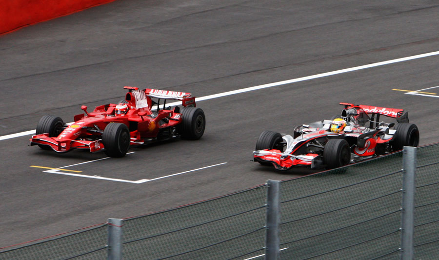 Lewis Hamilton overtakes Kimi Raikkonen after letting the Ferrari past