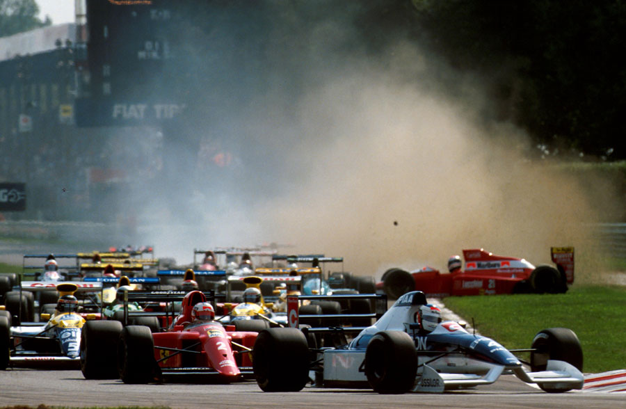 Jean Alesi leads Nigel Mansell at the start of the Italian Grand Prix