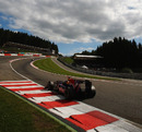 Mark Webber heads through Eau Rouge