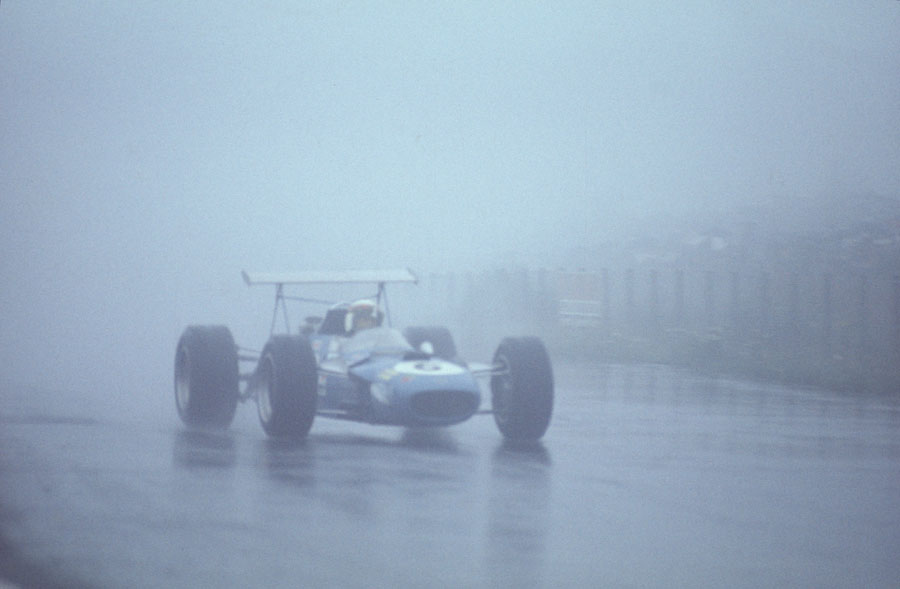 Jackie Stewart picks his way through the rain and fog to win the German Grand Prix by over 4 minutes