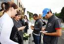 Bruno Senna and Sakon Yamamoto sign autographs outside their hotel
