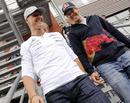 Michael Schumacher and Sebastian Vettel share a joke in the F1 paddock