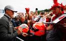 Michael Schumacher signs replica helmets