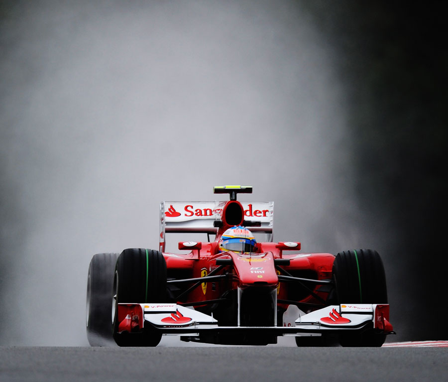 Fernando Alonso made the early running at a wet Spa Francorchamps on Friday