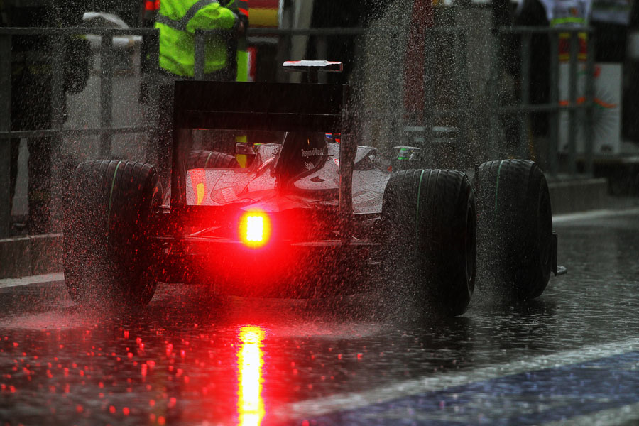 Sakon Yamamoto returns to the pits during a very heavy downpour