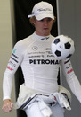 Nico Rosberg passes time in the Mercedes garage