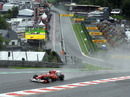 Fernando Alonso powers through Eau Rouge in the wet